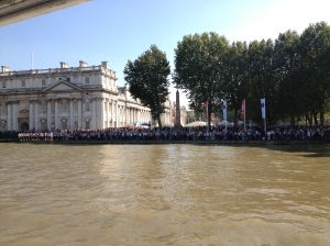 Crowds of people line the bank at Maritime Greenwich